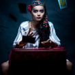 A portrait of a gypsy fortune teller throwing the tarot cards. — Stock Photo