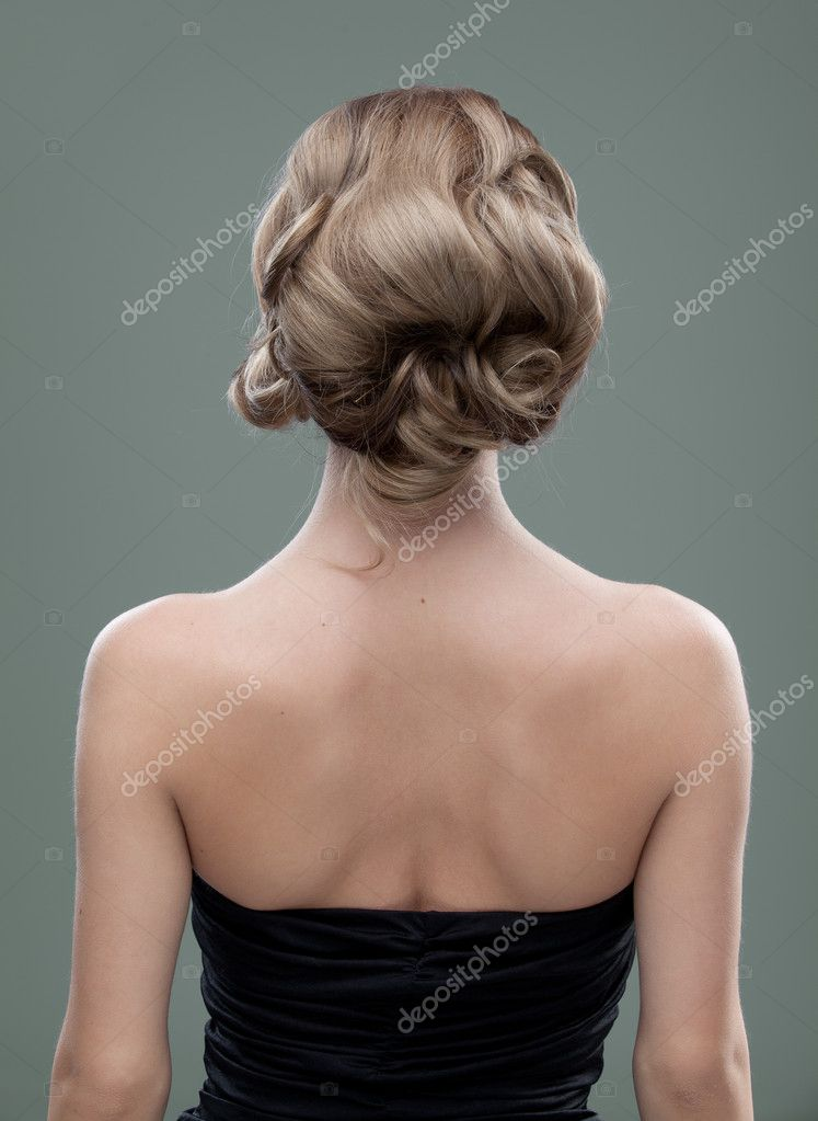 Head And Shoulders Back Image Of A Young Woman With