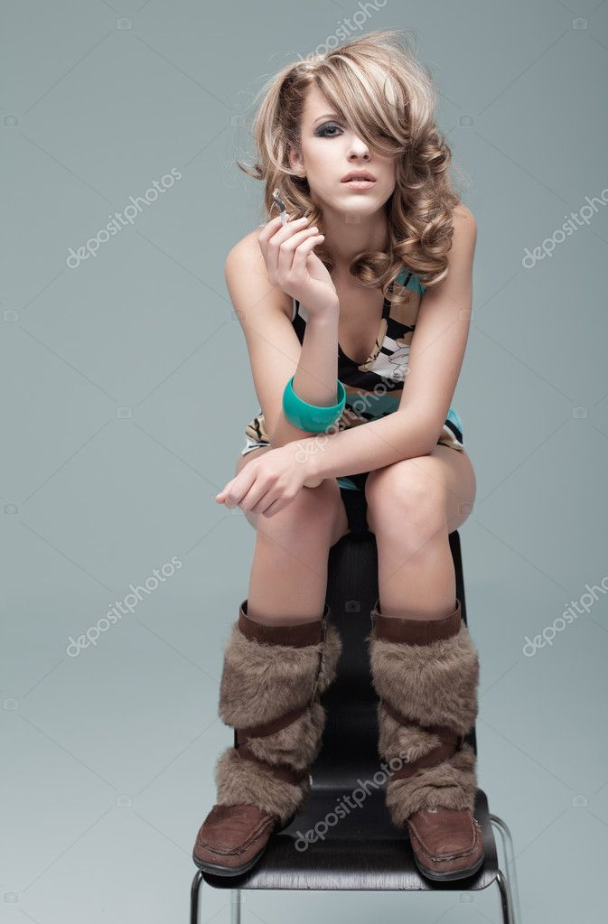 Blonde woman in 60s style make up and hairsty stock image 5254723