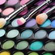 Royalty-Free Stock Photo: Eyeshadow kit with three makeup brushes