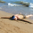 Photo: Mlaying on sand