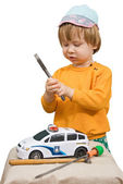 Baby boy heir childhood play toy tool repair — Stock Photo