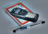 Notebook pen phone — Stock Photo