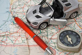 Toy car on a geographical atlas — Stock Photo