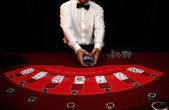Shuffle cards on casino — Stock Photo