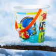 Toy bucket on the snow — Stockfoto