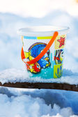Toy bucket on the snow — Stok fotoğraf