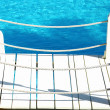 Stock Photo: Detail of a bridge on swimming pool