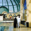 Arab family shopping in supermarket in Dubai - Stock Photo