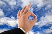 Hand Okay Sign In The Sky — Stock Photo
