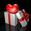 Stock Photo: Surprised 3d pop up heart in gift box