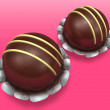 Two decorated chocolate on pink background — Stock Photo #4682943