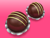 Two decorated chocolate on pink background — Stock Photo