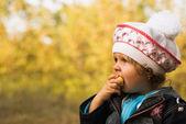 Girl in the fall garden — Stock Photo