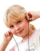 Little girl in headphones — Stok fotoğraf