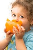 Little girl eating a big pepper — Stock Photo