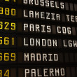 Airport departures board — Stock Photo