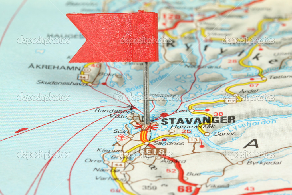 Stavanger - famous city in Norway. Red flag pin on an old map showing travel destination. — Stock Photo #4450322