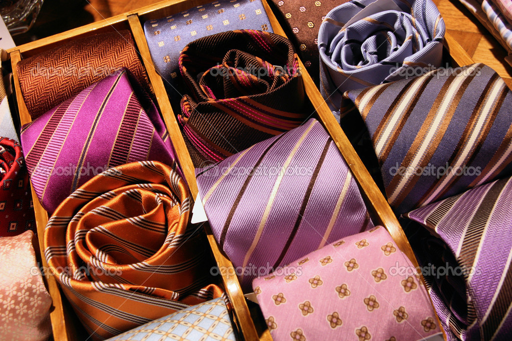 Shopping for elegant dressing accessories. Colorful ties at a shop in Italy. Formal wear selection in a store.  Stock Photo #4456266
