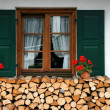 Firewood and window — Stock Photo