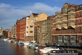 Bristol - boats and buildings seen from Redcliffe Bridge. United Kingdom. — Stock Photo