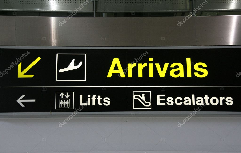 Arrivals, lifts and escalators signs at Dublin International Airport — Stock Photo #4463076