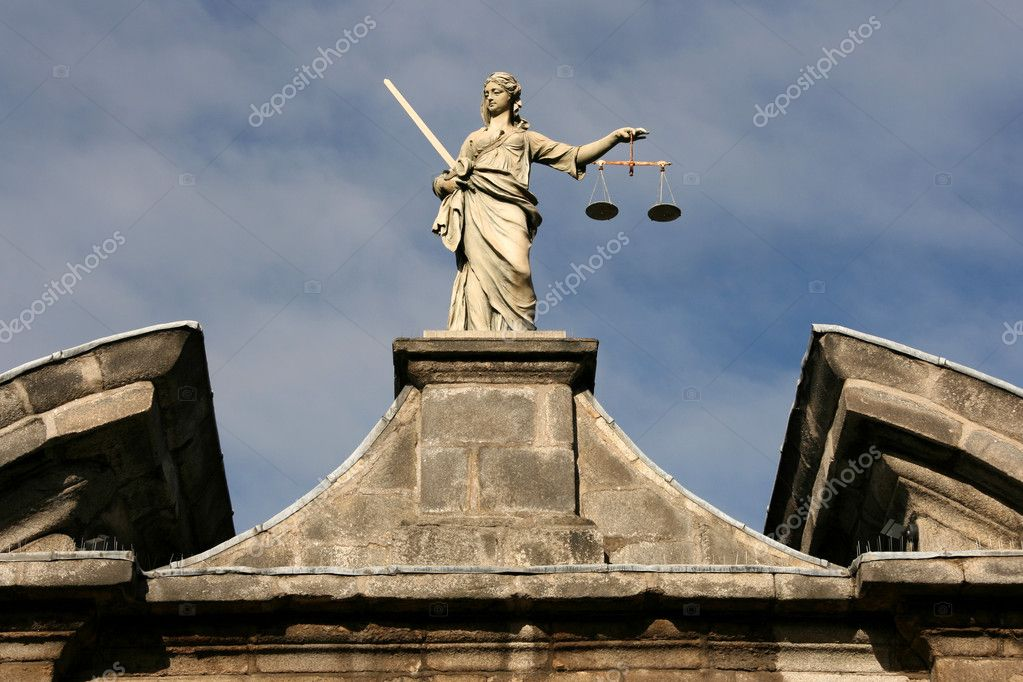 Statue of Justice on Dublin Castle wall.  Stock Photo #4463106