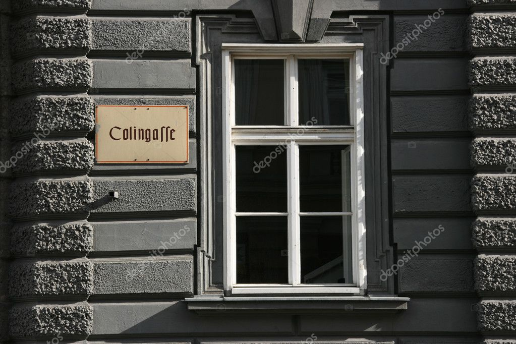 Old window and street name Colingasse in Innsbruck, Tirol, Austria — Stock Photo #4465573