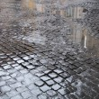 Stock Photo: Wet cobbled street in Rome