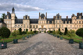 Fontainebleau castle in France. Chateau is inscribed to UNESCO world heritage list. — Stock Photo