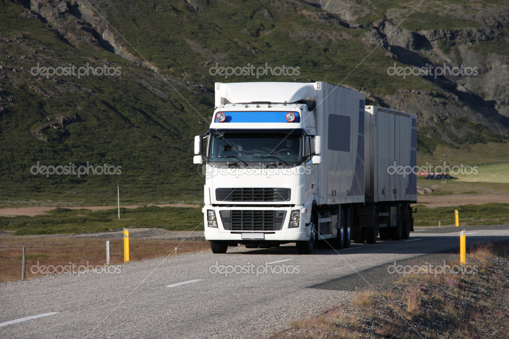 Huge white truck with a trailer. Cargo transportation in Iceland. — Stock Photo #4513986