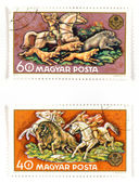 Postage stamps with hunting — Stock Photo