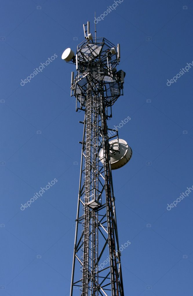 Wireless technology - mobile cellural phones development. Cell tower and blue sky. — Stock Photo #4527444