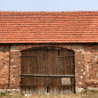 Royalty-Free Stock Photo: Old brick barn with wooden gate