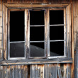 Blind window of abandoned house — Stock Photo