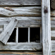 Old small window in wooden house — Stockfoto