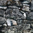 Old crumbling stone wall — Stock Photo