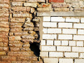 New and old brick walls joint — Stock Photo