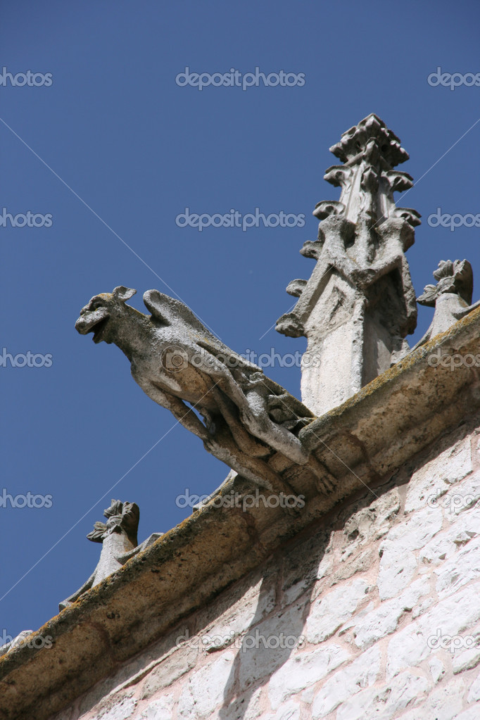 Gargoyle - decoration of Casa del Cordon, landmark of Burgos, Spain — Stock Photo #4543864