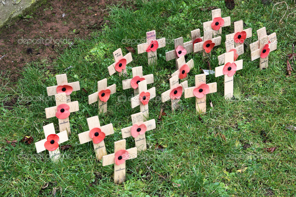 Miniature cemetery - tiny wooden crosses in the lawn of famous Coventry Cathedral (bombed in WW2), Great Britain. Remembrance of deceased soldiers. — Stock Photo #4556921
