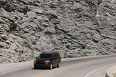 Mountain road and a car — Stock Photo
