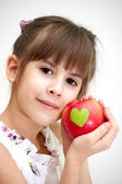 The girl with an apple — Stock Photo