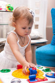 The little girl plays — Stock Photo