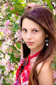 Portrait of the girl at an apple-tree — Stock Photo