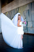 The bride in a white wedding dress with a bouquet — Stock Photo