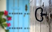 Brown door with key — Stock Photo