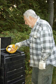 Senior ecologist and compost container — Stock Photo