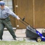 Lawn mower starting — Stock Photo