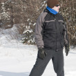 Stock Photo: Mwith snowshoes