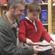 Stock Photo: Father and son sharing book